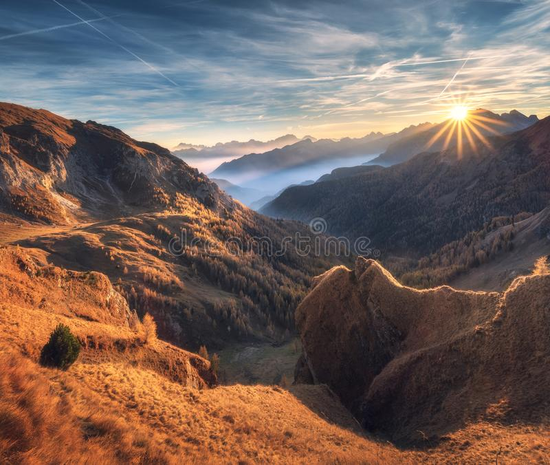 Mountains in fog at beautiful sunset in autumn. Dolomites, Italy royalty free stock photo