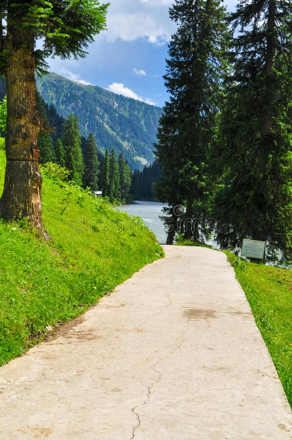 Mountains, forests and lake in Azad jammu and kashmir. Beautiful picture of mountains, forests and lake during daytime in Azad jammu and kashmir, Pakistan royalty free stock images