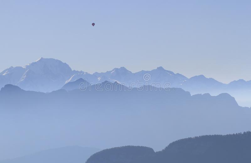 Mountains french alps with hot-air balloon royalty free stock image