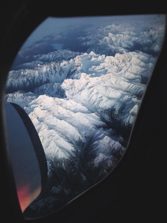 Mountains of Georgia country through the airplane window. View on earth from the window of the airplane. snow mountain range in Georgia royalty free stock images