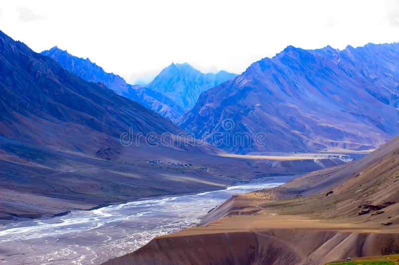 Mountains in Himalayas and dried river between royalty free stock image