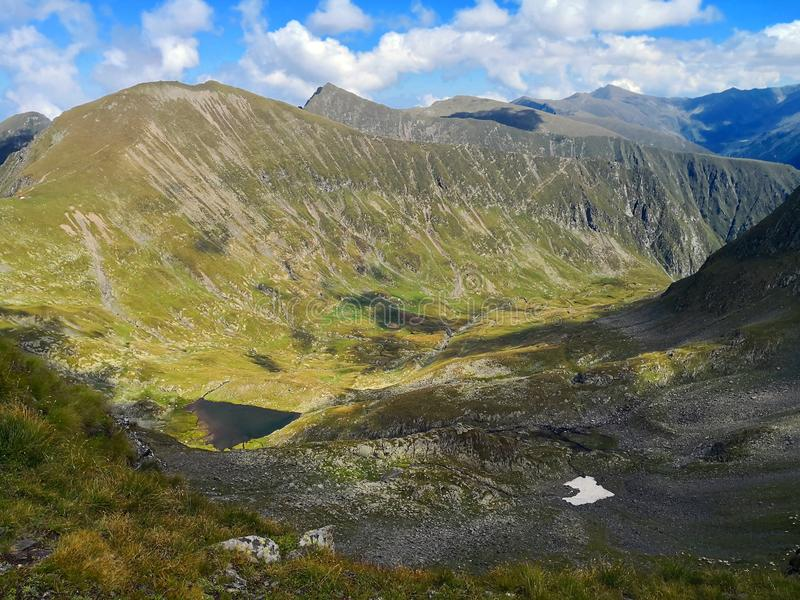 Mountains. Glacial Valley and lake under blue sky royalty free stock images