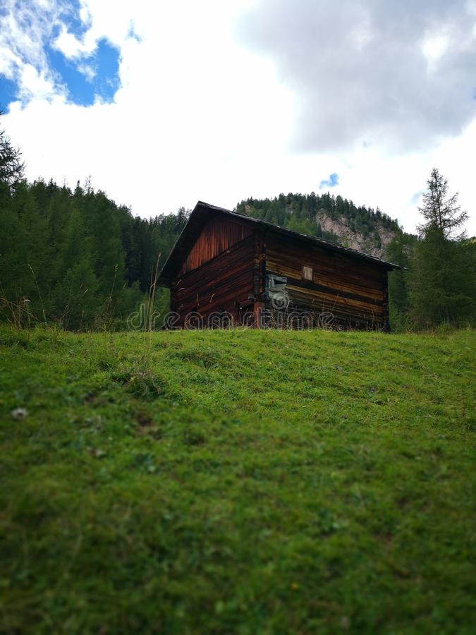 Hollibilly glimpse. Mountains Glimpse with a wooden cottage royalty free stock photo