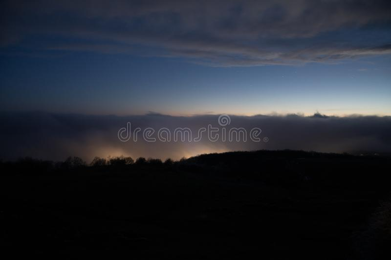 Mountains and Hills panoramic view of the landscape. villages and foggy area royalty free stock photo