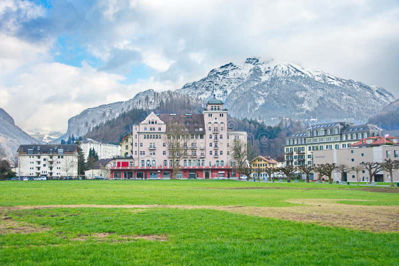 Mountains and historic architecture in Interlaken, Switzerland. INTERLAKEN, SWITZERLAND - APRIL 5, 2015: Beautiful snow-capped alpine views and historic stock photo