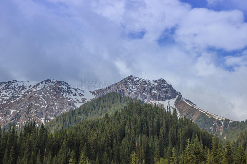 Mountains with ice peaks and cloudy sky, Central Tien-Shan, Kazakhstan royalty free stock photo