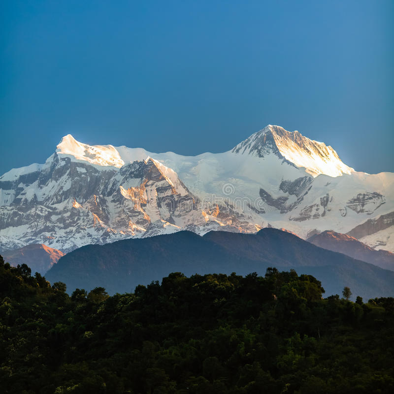 Mountains inspirational landscape view, Himalayas. Mountain inspirational beautiful sunset landscape in Himalaya Mountains. Himalayas Annapurna IV(7525m) and royalty free stock image