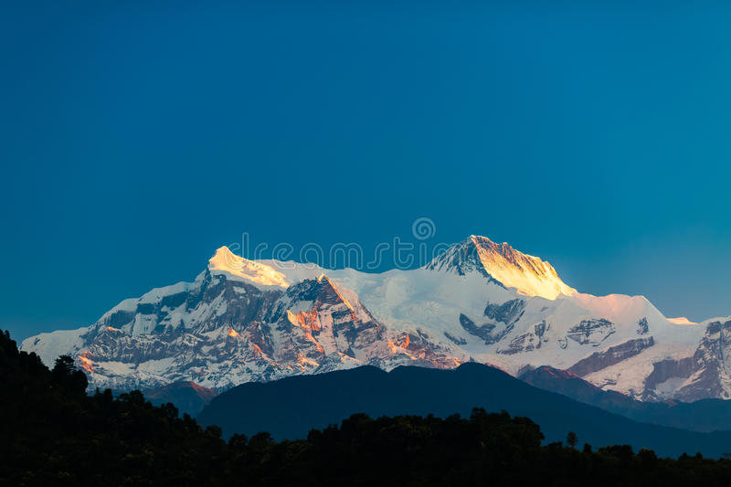 Mountains inspirational landscape view, Himalayas. Mountain inspirational beautiful sunset landscape in Himalaya Mountains. Himalayas Annapurna IV(7525m) and royalty free stock images