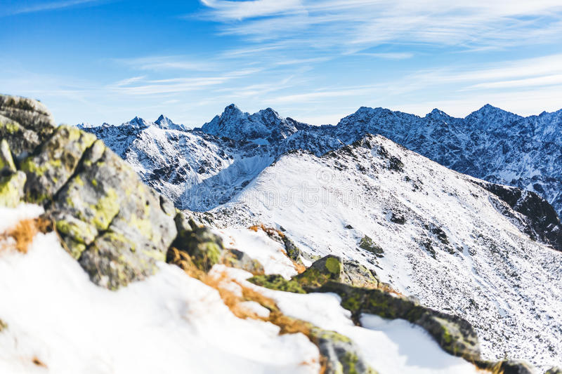 Mountains inspirational landscape view, sunny day in Tatra Mount. Ains. Mountain ridge over blue sunny sky, Poland royalty free stock photo