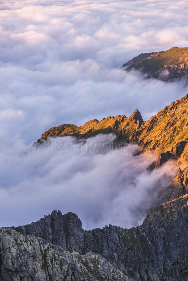 Mountains with Inversion at Sunset. Mountains Landscape with Inversion in the Valley at Sunset as seen From Rysy Peak in High Tatras, Slovakia stock photography