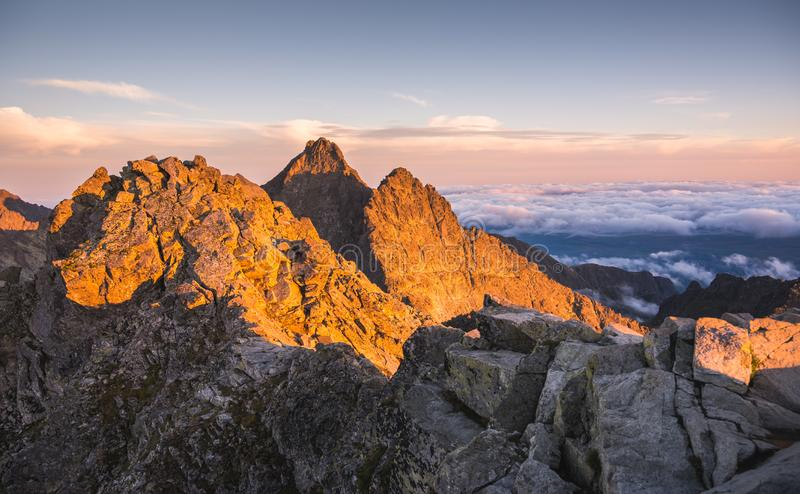 Mountains with Inversion at Sunset. Mountains Landscape with Inversion in the Valley at Sunset as seen From Rysy Peak in High Tatras, Slovakia royalty free stock photography