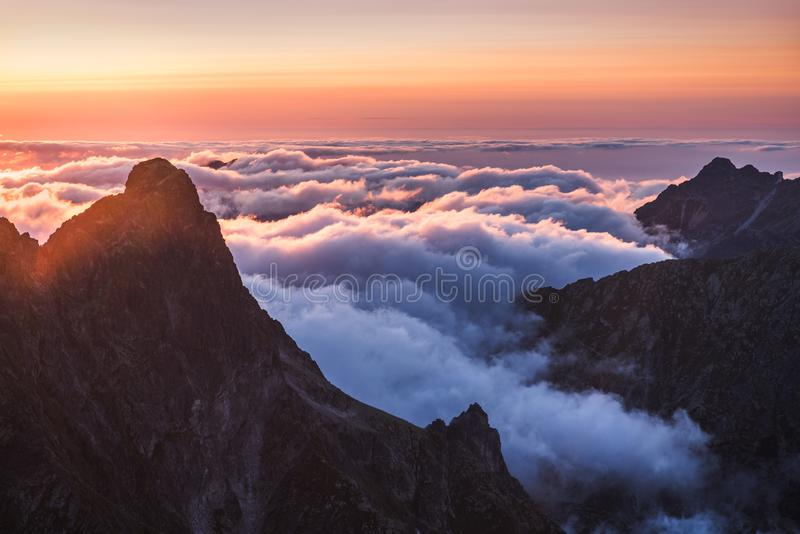 Mountains with Inversion at Sunset. Mountains Landscape with Inversion in the Valley at Sunset as seen From Rysy Peak in High Tatras, Slovakia stock photo