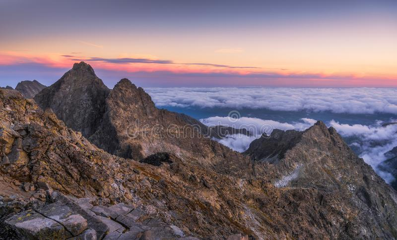 Mountains with Inversion at Sunset. Mountains Landscape with Inversion in the Valley at Sunset as seen From Rysy Peak in High Tatras, Slovakia royalty free stock photo