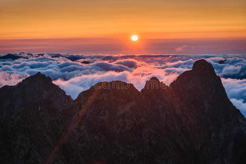 Mountains with Inversion at Sunset. Mountains Landscape with Inversion in the Valley at Sunset as seen From Rysy Peak in High Tatras, Slovakia royalty free stock image
