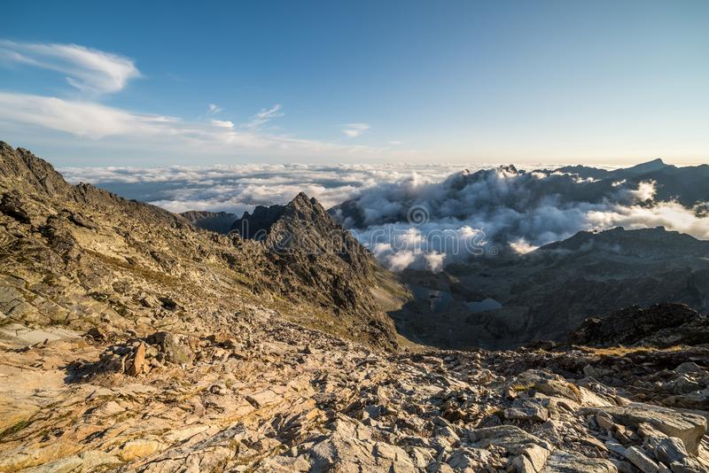 Mountains with Inversion at Sunset. Mengusovska Valley with Inversion as Seen from Rysy Peak in High Tatras, Slovakia stock image