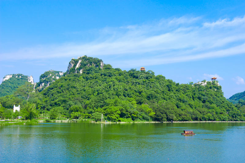 Mountains and lake. Mountain lying still in the lake, against the background of blue sky royalty free stock photography