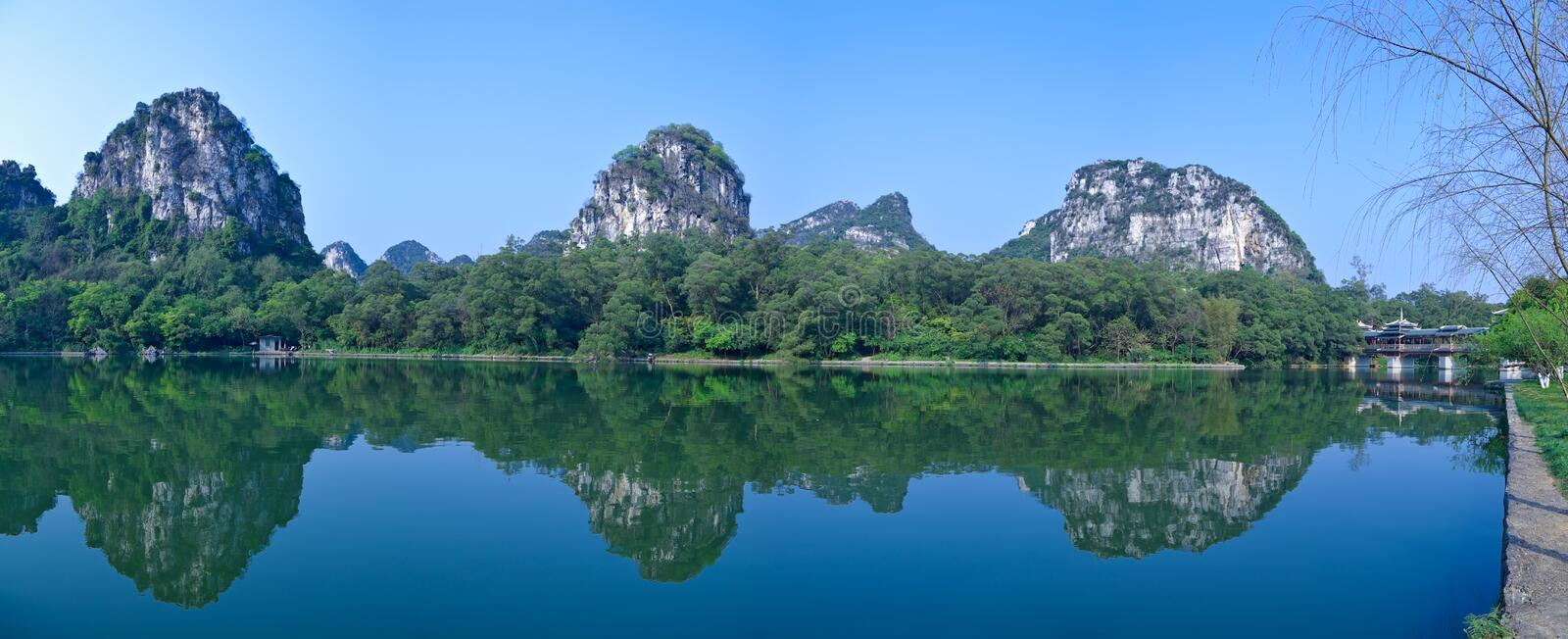 Mountains and lake. Natural karst landscapes ,mountains reflection in the lake stock image