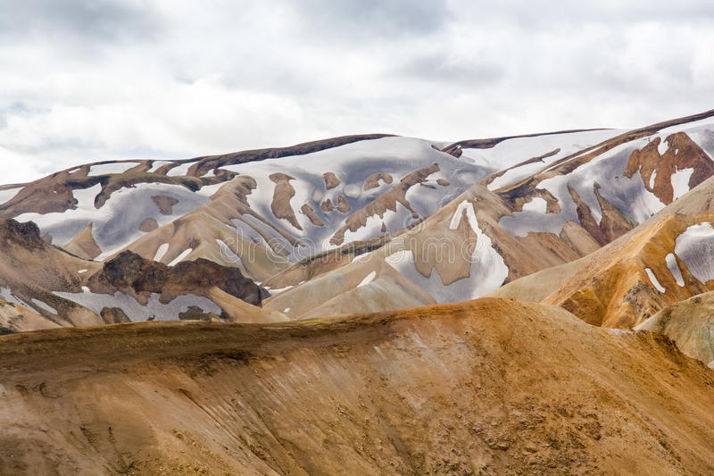 Mountains of the Landmannalaugar. Landmannalaugar is a high place of tourism in Iceland with rhyolite mountains , lava field and hot springs royalty free stock photography