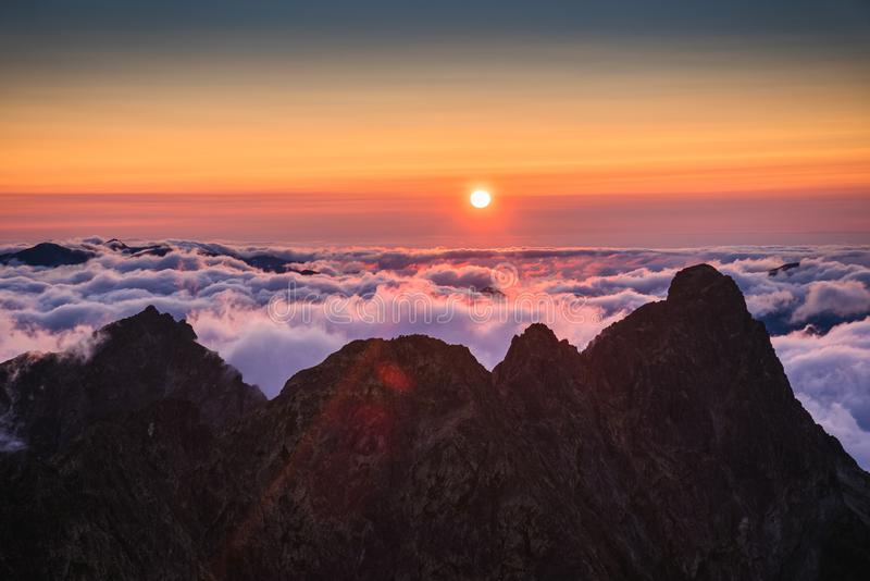 Mountains with Inversion at Sunset. Mountains Landscape with Inversion in the Valley at Sunset as seen From Rysy Peak in High Tatras, Slovakia royalty free stock photos