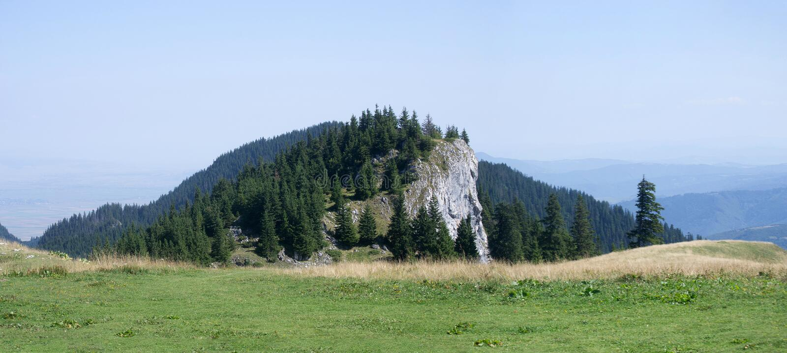 Panoramic view - Big Rock Mountains, Transylvania, Romania. Mountains landscape panoramic view with big rock and clear blue sky in the alpine zone of Big Rock royalty free stock photo