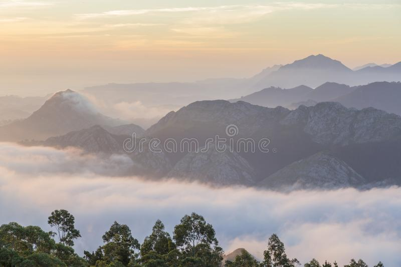 Majestic mountains landscape under morning sky with clouds. Fog. Asturias, Spain. royalty free stock photography