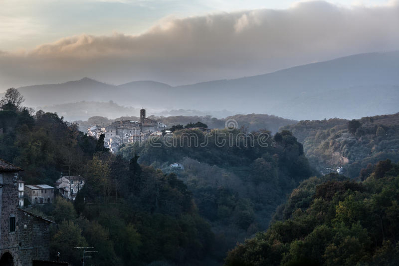 Mountains and landscapes. Medieval italian villages. Vignanello (Village in central Italy). Beautiful view with mountains and cloudy sky. Twilight scene royalty free stock photo