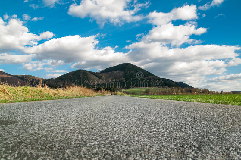 Mountains and meadows at sunny day royalty free stock photography