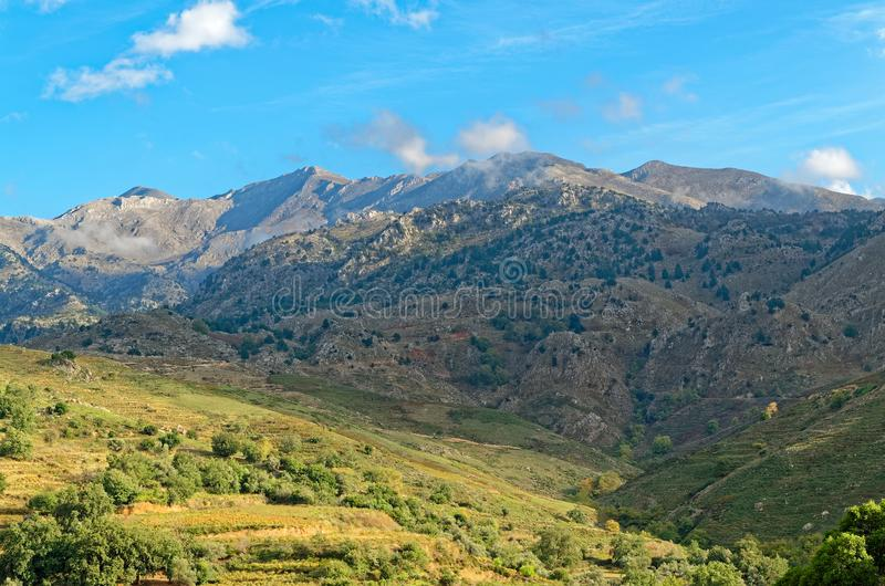 Mountains and meadows under blue sky. On the island Crete, Greece stock photography