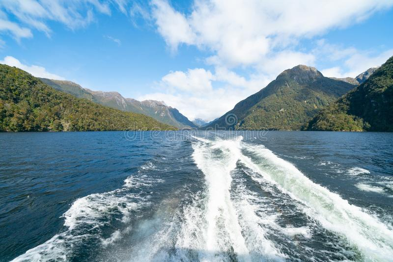 Mountains meet the sea of Doubtful Sound. In peaceful natural environment royalty free stock photos