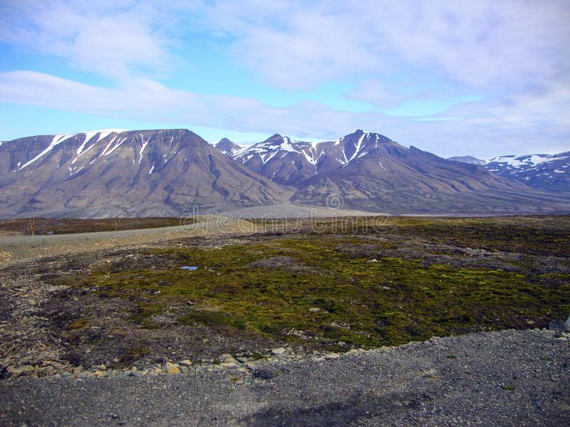 Mountains and melting permafrost on Spitzbergen, Norway. Spitzbergen - also called Svalbard, is a large group of glaciated volcanic islands - part of Norway in royalty free stock photos