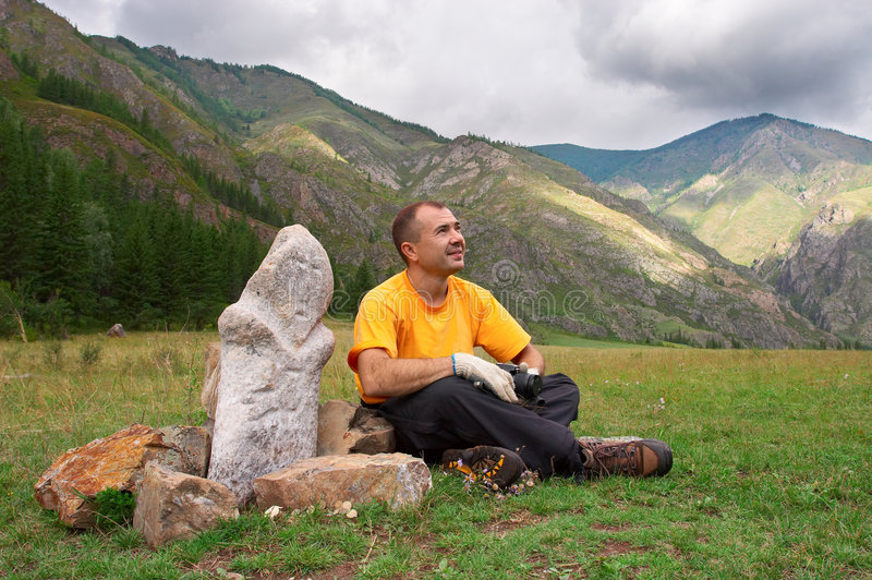 Mountains, men and idol. Altay. Russia royalty free stock photo