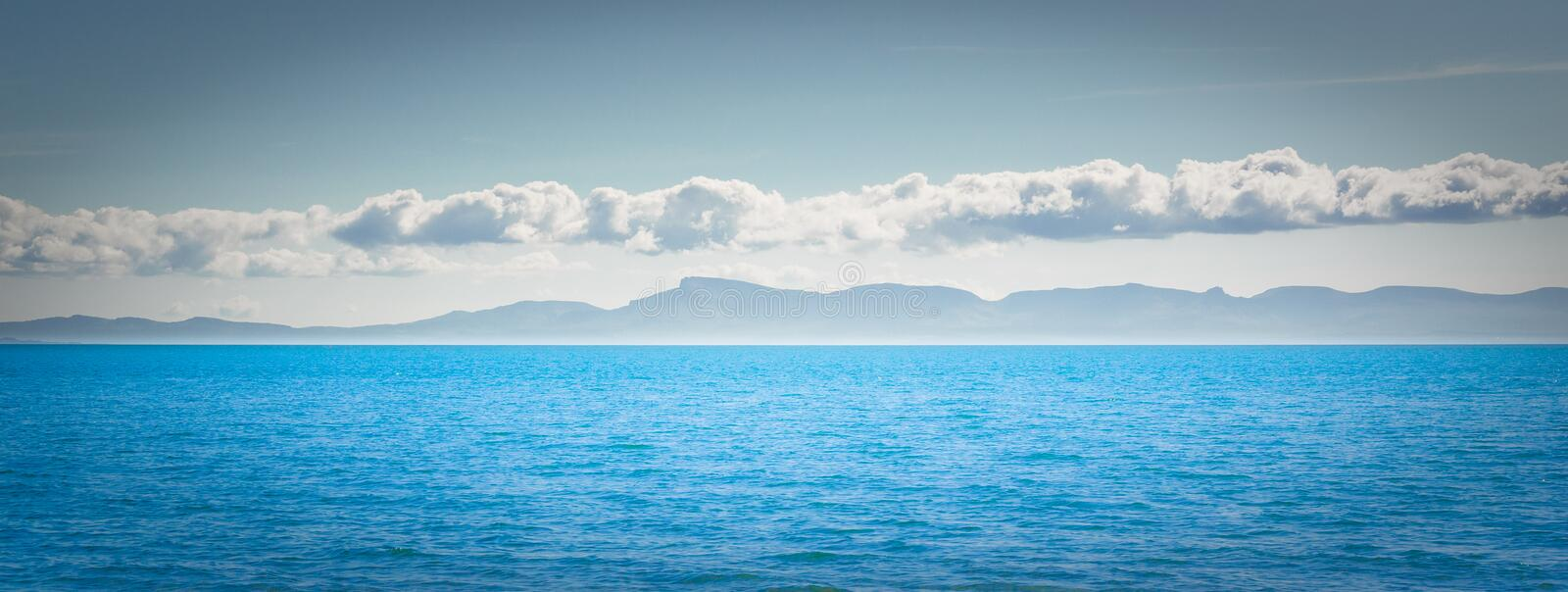 Mountains and ocean around Isle of Skye. Panorama - landscape royalty free stock images
