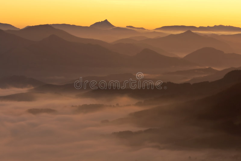 Mountains over the fog stock photo