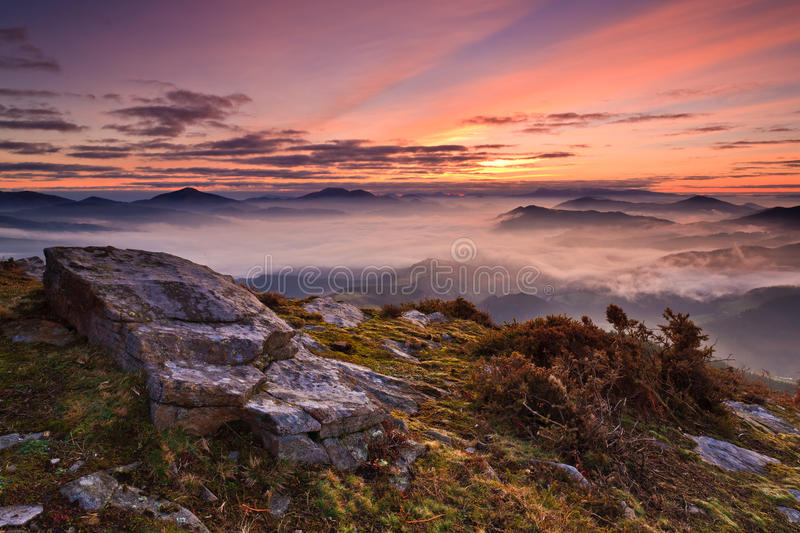 Mountains over the fog stock images