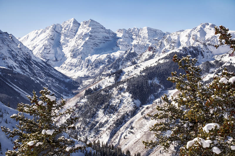 Mountains Over Maroon Valley. A view of the Maroon Valley landscape looking towards the two mountains of the Maroon Bells in Pitkin Country royalty free stock photography