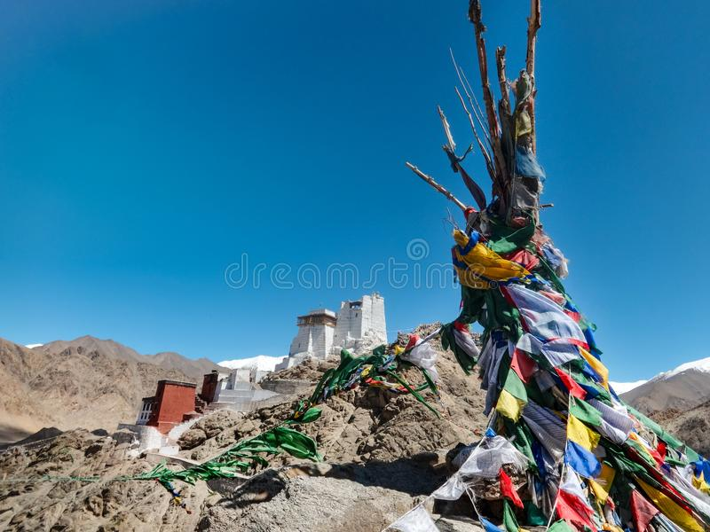 Mountains with prayer flags and views to the old castle of Leh royalty free stock photo