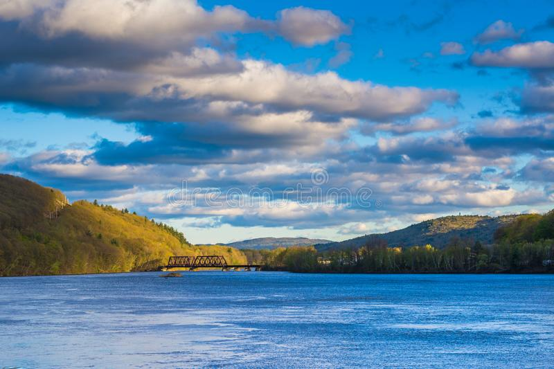 Mountains and railroad bridge over the Connecticut River, in Brattleboro, Vermont stock photography