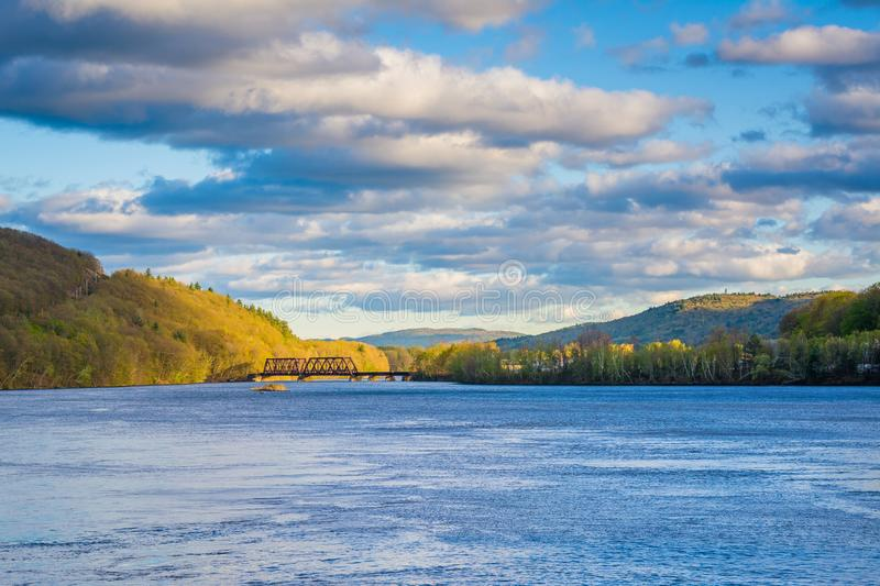 Mountains and railroad bridge over the Connecticut River, in Brattleboro, Vermont royalty free stock images