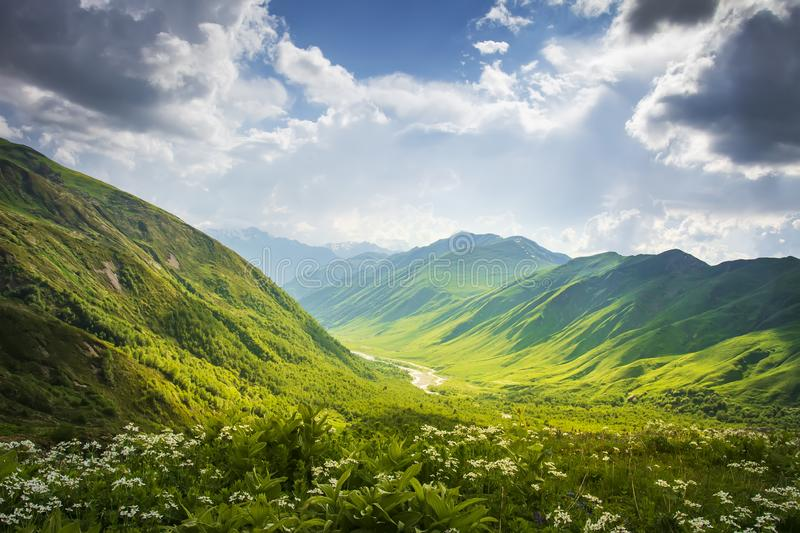Mountains ranges. Mountain landscape in Svaneti, Georgia. Beautiful view on grassy hills and highlands on summer sunny day royalty free stock photos