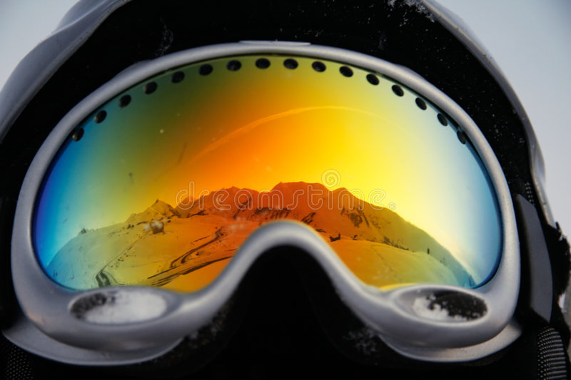 Mountains reflected in glasses stock photos