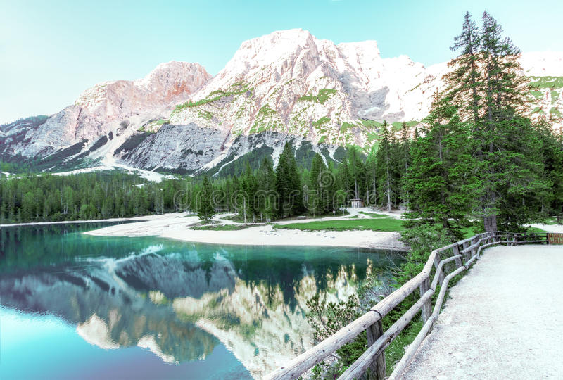 Mountains reflecting in alpine lake stock photos