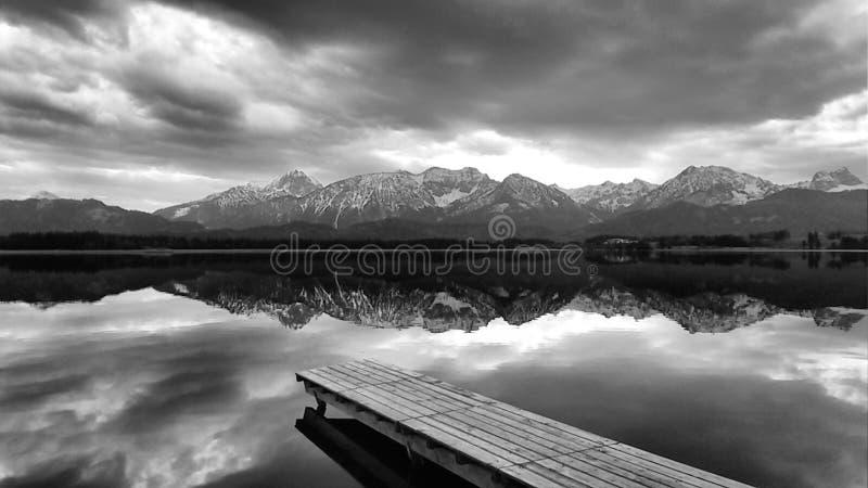 Mountains reflecting on lake stock photo