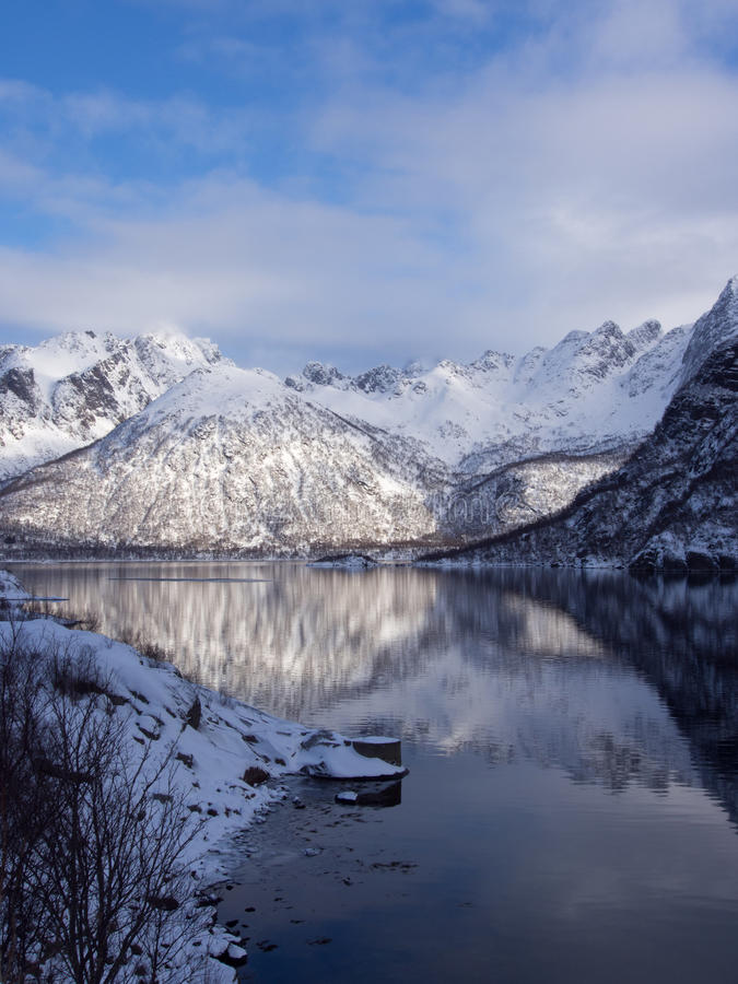 Mountains reflecting in the sea on Lofoten, Norway royalty free stock image