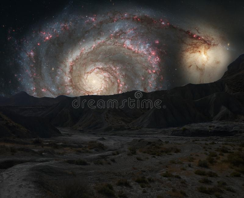 Mountains ridges on the background of outer space galaxy stock photography