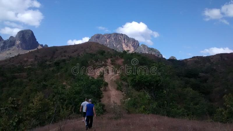 Mountains of San Juan de los Morros, Venezuela. Two men walk through nature by a national park trail in San Juan, Guarico, Venezuela, South America stock photos