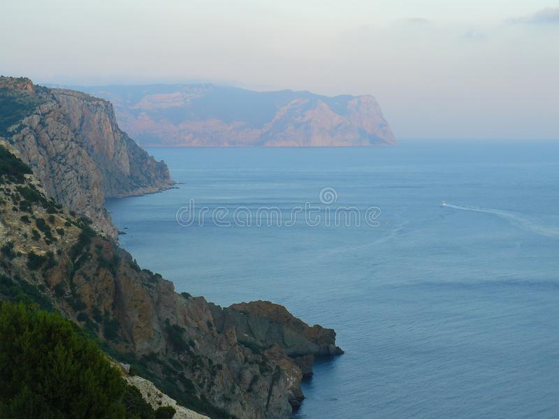 Mountains, sea and sky in summer royalty free stock photos