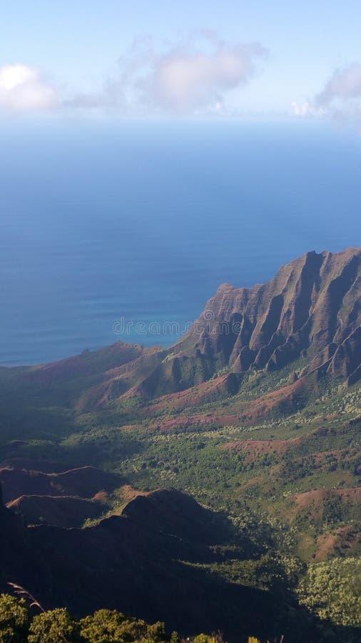 Sea the mountain. Mountains  sea wiamea bluewater redrocks landscape hawaii kauai green stock photos