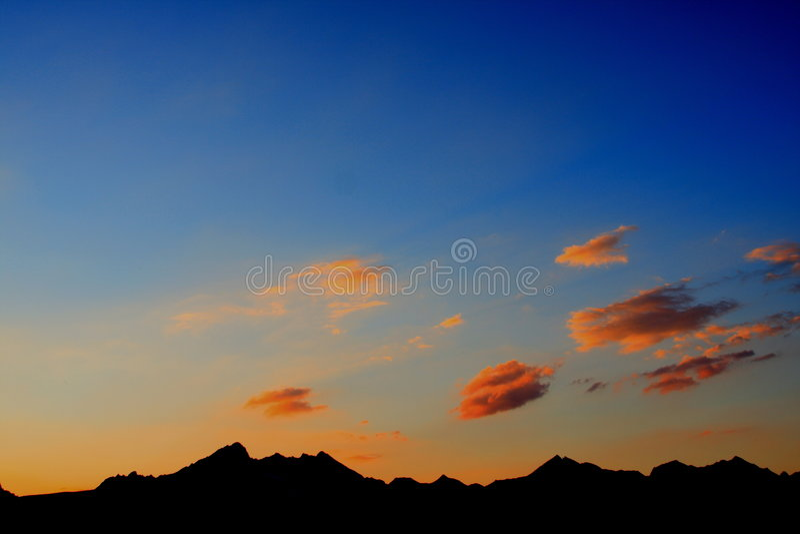 Mountains silhouette at dusk royalty free stock photos