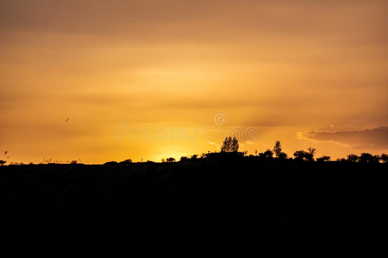Mountains Silhouette Under Beautiful golden sky royalty free stock image