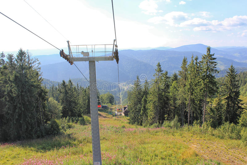 The mountains. The ski lift in the high mountains in the summer stock image